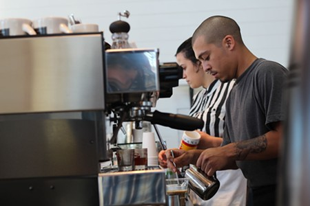 CAFFEINE SCENE Jasmine Partida and Cary Escovedo at Acre Coffee, where the process is as important as the result. - NICOLAS GRIZZLE