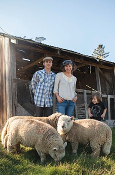 CIDER LEAN Scott Heath and Ellen Cavalli in front of the namesake tilted shed, while son Benny gets silly with the sheep.