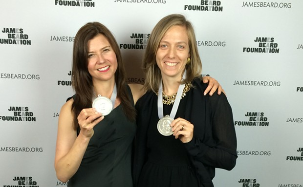 """Civil Eats' Naomi Starkman, left, and Paula Crossfield celebrate their """"publication of the year"""" award from the James Beard Foundation."""