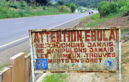 DANGER AHEAD A sign warns travelers in the Congo of the Ebola threat. - SERGEY URYADNIKOV / SHUTTERSTOCK.COM