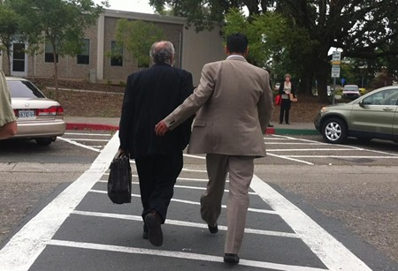 Efren Carrillo, right, leaves the courthouse with attorney Chris Andrian. - GABE MELINE