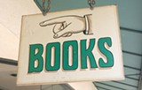 ENTER! Treehorn's sign compels the bibliophile in off the street.