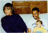 FAMILY TIME Hicks holds his daughter on his lap. Seated next to him in her home is his mother, Wanda Salvatto. - JOHNETTA DEDRICK
