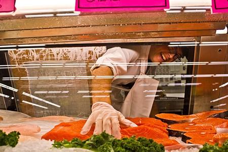 FILLETS, STEAKS OR WHOLE? Justin Hughes pulls the fresh stuff at G&G Supermarket in Santa Rosa. - NADAV SOROKER