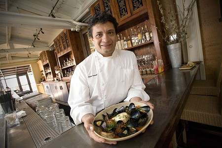 FROM THE STREET Mateo Granados shows off a plate of seafood costeño at his new brick-and-mortar joint. - MICHAEL AMSLER