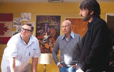 GOOD TO GO Go Alan Arkin considers man-hugging John Goodman in Ben Affleck's 'Argo.'