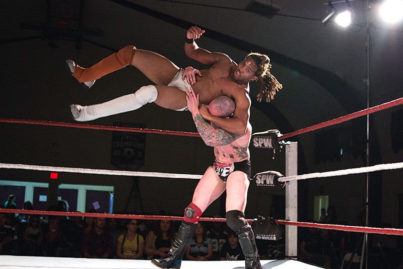 HIGH FLIER Marcus Lewis tries to keep his headlock on opponent Adam Thornstowe. - ERIC MOLYNEAUX