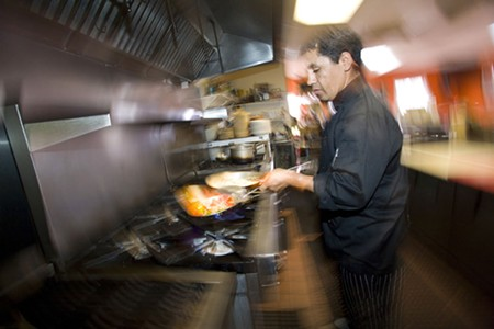HOT SPRINGS Chef and co-owner Antonio Barrios prepares chicken huaraches at Rancho Viejo. - MICHAEL AMSLER