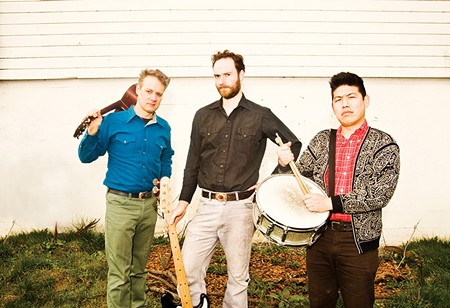 INDIE ICON Calvin Johnson, center, says his hometown of Olympia, Wash., is a hive of progressive musicians.