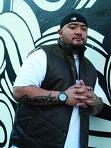 ISLAND LIFE J Boog may be based in Hawaii, but his tattoos rep Compton.