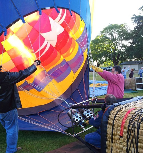 Jimmy Long fills his hot air balloon, the Sonoma Star, Friday for a preview flight for the Windsor Hot Air Balloon Classic this weekend. - NICOLAS GRIZZLE