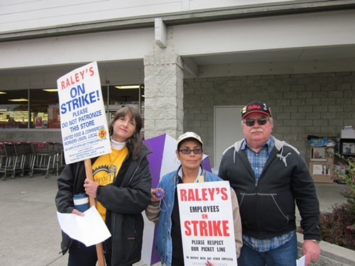 Kelly Fernandez, Olga Arvin and Joe Colosi hold down the picket line at Raleys on Fulton Road in Santa Rosa.