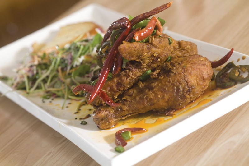 KFC, WEST COUNTY STYLE Hi Five's Korean fried chicken is rolled in rice flour, fried and served with a soy-ginger sauce. - MICHAEL AMSLER