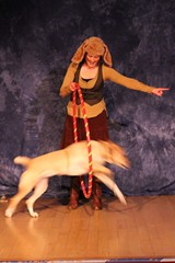 PHOTO BY SHELLEY RUGG - Laurel Britton does dog tricks with her dog, Inti, at the last 10x10 performance lab.