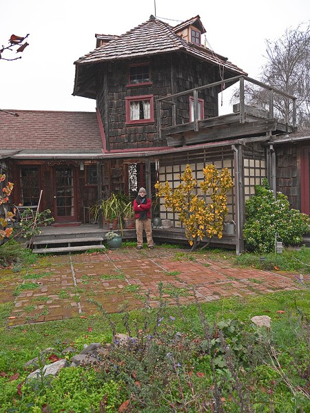 Lloyd Kahn, in front of his own Bolinas home.