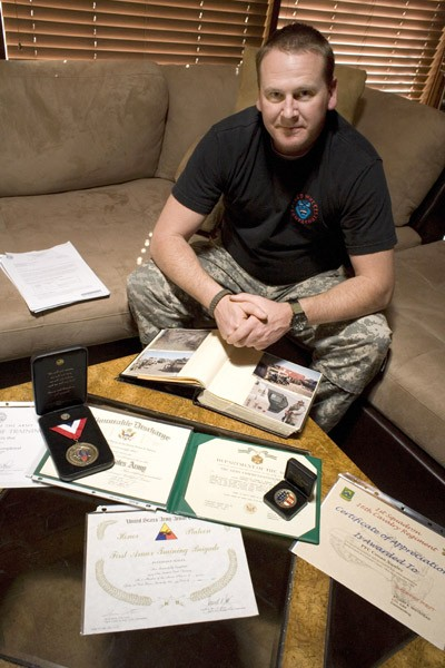 MERIT Conan Nunley, now on permanent disability, with his awards and medals for service in Iraq. - MICHAEL AMSLER