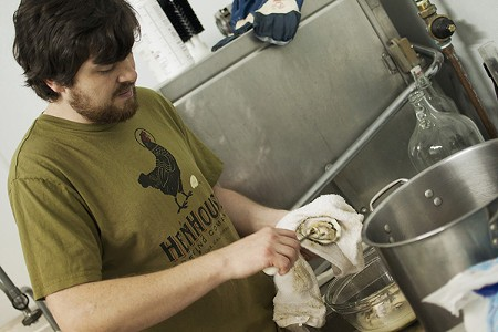 MOLLUSK & SPICE HenHouse's Shane Goepel shucks oysters for a batch of oyster stout. - ANNELIESE SCHMIDT