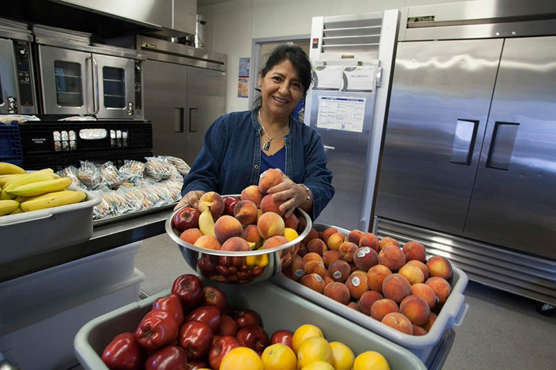 NO MORE TATER TOTS Hortencia Garcia, food service manager at Roseland Elementary, prepares fresh produce for students. - MICHAEL AMSLER