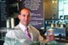 <b>NOW YOU SEE IT . . .</b> John-Paul Scirica serves delicious ice cream and tasty illusions at his new ice cream shop/magic theater.