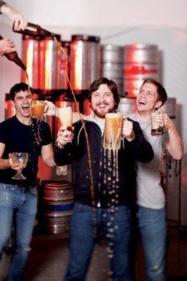 REIGN IN BEER: Eliott Whitehurst, Shane Goepel and Alex Whitehurst (L-R) revel in their various homemade libations. - SARA SANGER