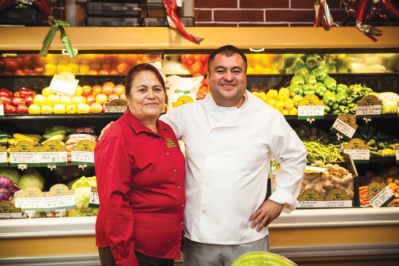 SHARED PASSION Octavio Diaz with mother Juana, who routinely travels to Oaxaca to buy ingredients for her famed mole. - SARA SANGER