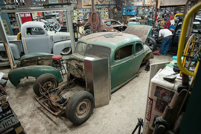 SHOP OF CHOPS Jorge Vega works away at one end of the garage, where a '41 Hudson and a '51 Ford pickup await their turns. - GREGORY HAYES