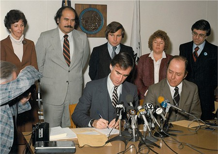 SIGNED, SEALED, DELIVERED Under the watchful eye of then–Secretary for Resources Huey Johnson, Gov. Jerry Brown signs the $120 million Energy and Resources Fund to put money toward alternative energy and natural resources investments on Sept. 17, 1980 - PHOTO COURTESY THE RESOURCE RENEWAL INSTITUTE