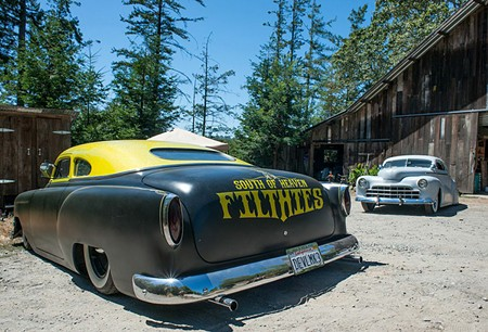 SITTIN' PRETTY A signature South of Heaven '54 Chevy sedan sits super low in front of the garage, with a primered '47 Ford coupe in the background. - GREGORY HAYES