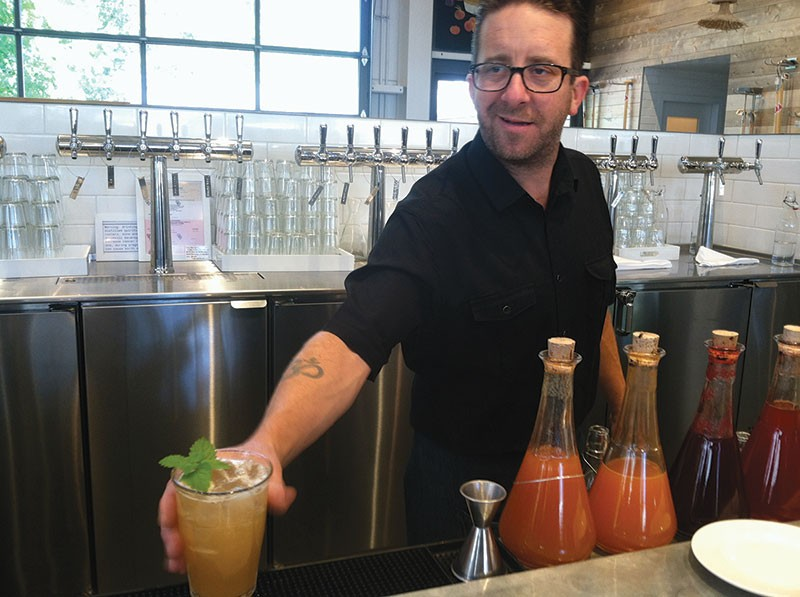 SWEET AND SOUR POWER SHED's Ryan Birre prepares a shrub at the restaurant's 'fermentation bar.' - STETT HOLBROOK