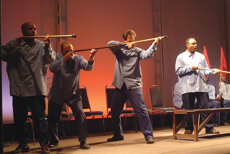TAKING AIM Inmates in the play had to use canes instead of toy guns as props.