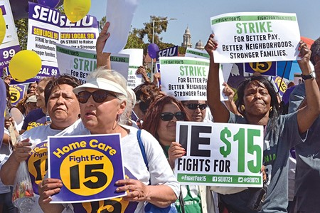 FOR A FEW DOLLARS MORE California in-house support workers agitate for better pay earlier this year, goshdarnit. - DAN HOLM