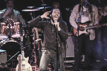 PLAY I SOME MUSIC Ziggy Marley won a Grammy last year, but he says he is more interested in spreading happiness with his music than winning awards.