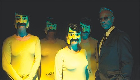 IMAGINE IT A Trump-esque CEO (Brent Lindsay, right) and his army of inflatable dolls hunt for the immaculate Star Child in new play from the Imaginists.