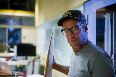 THE CURATOR Richard Kenvin laments he spends more time studying surfboards than riding them.