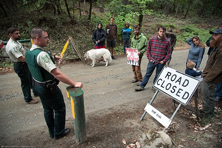 FACE OFF Foes of a logging project in the Klamath National Forest blocked a logging road in May to protest the plan. - BROOKE ANDERSON
