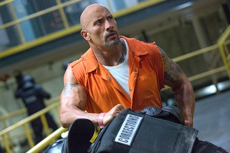 MUSCLE-CARS, MUSCLE-MEN  Dwayne Johnson is one of several bald, muscle-bound men in this movie about fast cars and world destruction.