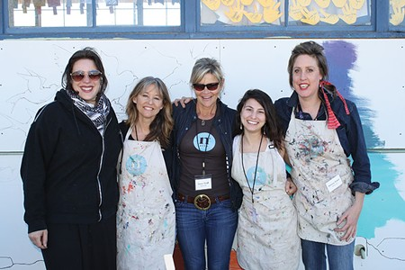 SEE, ART MAKES YOU SMILE Jamie Graff, center, and the Nimbus staff aren't afraid to dirty some aprons in the name of art.