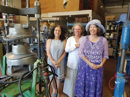 MAD FOR HATS  Jennifer Webley, left, Gould Hat Designs' milliner Jessica Gould, center, and Portobello Hats' manager Josephine Mayo have a new place to hang  their hats at the Hattery.