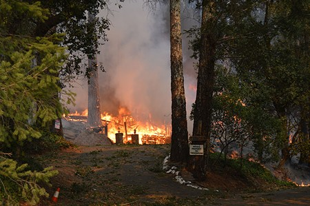 Fire engulfs a home on Wild Lilac Lane Monday. - TOM GOGOLA