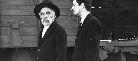 STRANGERS  A Jewish father and son set a town on edge in post-WWII drama.