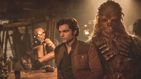 WHEN HAN MET CHEWY  Alden Ehrenreich (left), and a guy in a hairy suit, present Han Solo's origin story.