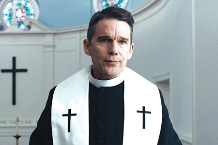 SINNERS AND SAINTS Ethan Hawke plays a dour pastor who oversees a 250-year-old church and a wayward flock.