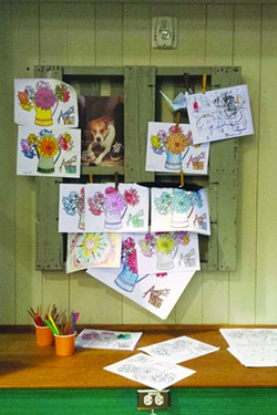 HOMETOWN HERO Amy's plays up a family-friendly vibe with a display of crayon art inside the restaurant. - MICHAEL AMSLER