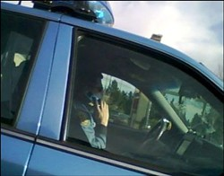 This photo is courtesy of teensagainst distracteddriving.com. Message? Put the phone down, Mr. Policeman—it's the law.