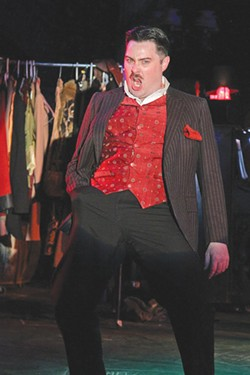SHARP WIT Jerry Lee menaces wonderfully as the knife-wielding Macheath, king of the thugs. - ERIC CHAZANKIN