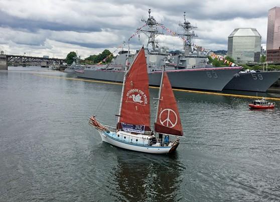 sara-golden-rule-in-front-of-2-war-ships.jpg