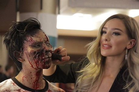 EllieMacs SFX applies makeup to a zombie at the Silver Scream Fest.