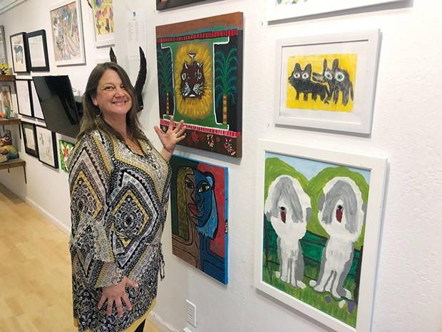 NATURAL HABITAT Alchemia Artistic Director Liz Jahren admires painted representations of artists' animal sides. - DAVID TEMPLETON