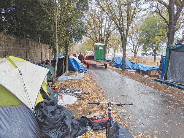 TEMP TOILETS Sonoma County residents funded eight temporary toilets for a homeless encampment along Joe Rodota Trail. - GREGORY FEARON