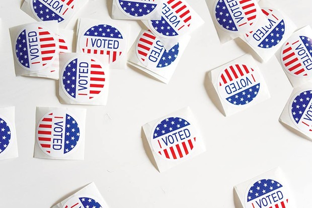 IN PERSON Not only will you not receive a sticker if you vote by mail, you may not get a say in the presidential primary if you haven't picked a party. - ELEMENT5 DIGITAL